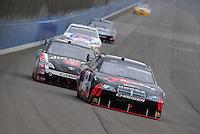 Oct. 11, 2009; Fontana, CA, USA; NASCAR Sprint Cup Series driver David Stremme (12) leads Robby Gordon (7) during the Pepsi 500 at Auto Club Speedway. Mandatory Credit: Mark J. Rebilas-