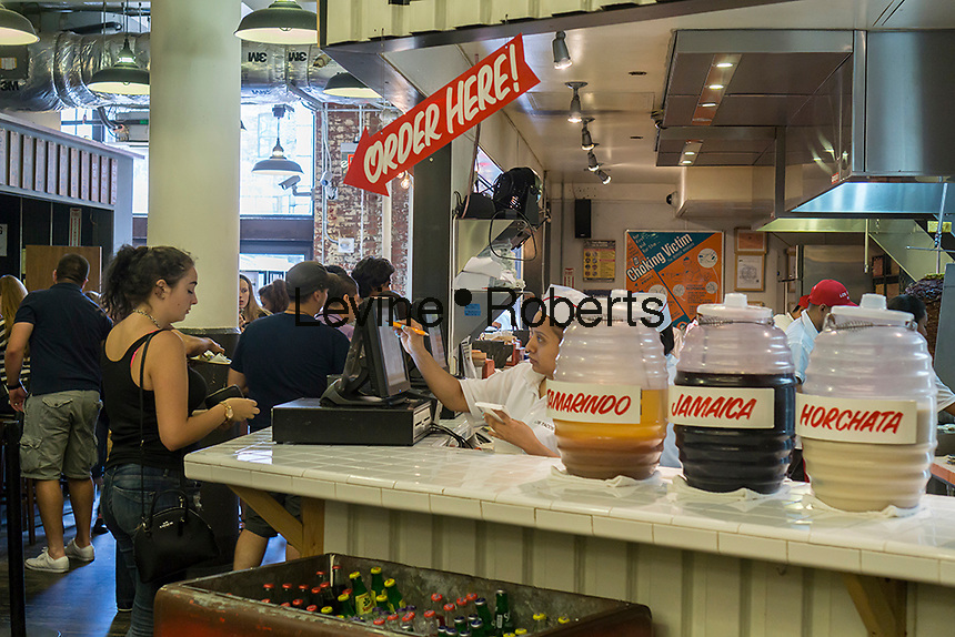 Mexican food taco stand in the former Nabisco bakery in New York, now the trendy Chelsea Market, on Friday, July 17, 2015. The owners of the building, Jamestown Properties converted the building into a food arcade and office building in the 1990's t. (© Richard  B. Levine)