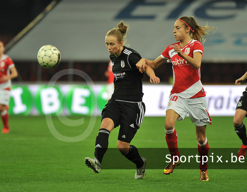 20131009 - LIEGE , BELGIUM :  Glasgow Eilish McSorley pictured with Standard's Tessa Wullaert (right) during the female soccer match between STANDARD Femina de Liege and  GLASGOW City LFC , in the 1/16 final ( round of 32 ) first leg in the UEFA Women's Champions League 2013 in stade maurice dufrasne - Sclessin in Liege. Wednesday 9 October 2013. PHOTO DAVID CATRY