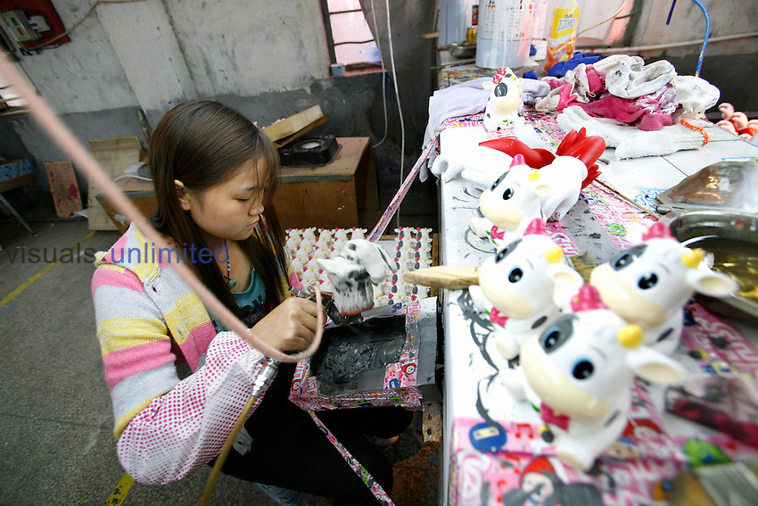 Worker in a plastic toy factory, Fengxiang, Shanghai, China