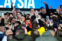 Joe Rodon of Swansea City is mobbed in the stands by Swansea fans during the Sky Bet Championship match between Cardiff City and Swansea City at the Cardiff City Stadium in Cardiff, Wales, UK. Sunday 12 January 2020