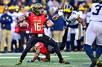 College Park, MD - NOV 11, 2017: Maryland Terrapins quarterback Ryan Brand (16) in the pocket pursued by Maryland Terrapins defensive back JC Jackson (7) during game between Maryland and Michigan at Capital One Field at Maryland Stadium in College Park, MD. (Photo by Phil Peters/Media Images International)