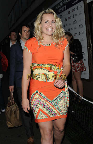 Chimene &quot;Chemmy&quot; Mary Alcott<br /> attended the Slazenger Wimbledon Party, Whisky Mist bar &amp; nightclub, Hertford St., London, England, UK, 27th June 2013.<br /> half length orange dress print smiling yellow <br /> CAP/CAN<br /> &copy;Can Nguyen/Capital Pictures