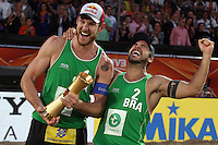 Alison Cerutti (L) from Brazil celebrates with his teammate Bruno Oscar Schmidt (R) during the FIVB Beach Volleyball World Championships Male Final  Match between Brazil vs Netherlands  on July 5, 2015 in The Hague, Netherlands. Photo by Paulo Amorim