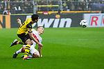 09.03.2019, Signal Iduna Park, Dortmund, GER, 1.FBL, Borussia Dortmund vs VfB Stuttgart, DFL REGULATIONS PROHIBIT ANY USE OF PHOTOGRAPHS AS IMAGE SEQUENCES AND/OR QUASI-VIDEO<br /> <br /> im Bild   picture shows:<br /> Raphael Guerreiro (Borussia Dortmund #13) kl&auml;rt vor Santiago Ascacibar (VfB Stuttgart #6), <br /> <br /> Foto &copy; nordphoto / Rauch