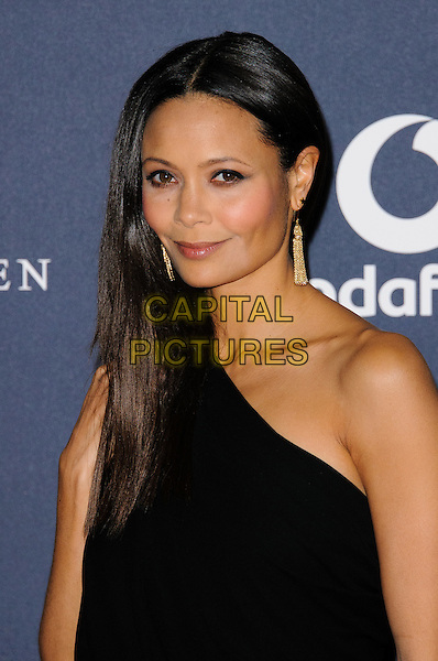 Thandie Newton.Arrivals at the Laureus 2012 World Sports Awards held at the Queen Elizabeth II Centre, London, England..February 6th, 2012.headshot portrait black one shoulder dangling gold earrings .CAP/CJ.©Chris Joseph/Capital Pictures.