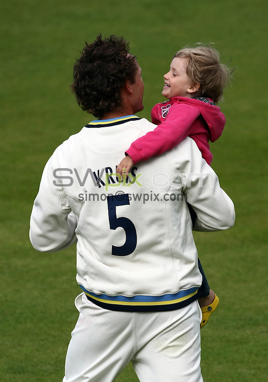 PICTURE BY VAUGHN RIDLEY/SWPIX.COM - Cricket - LV County Championship - Yorkshire v Hampshire, Day 2 - Headingley, Leeds, England - 24/09/09...Copyright - Simon Wilkinson - 07811267706...Yorkshire's Deon Kruis daughter, Ele, watches her dad play in his final match for Yorkshire.