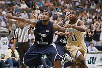 February 24, 2012:    North Florida Ospreys forward Travis Wallace (1) tries to block out Jacksonville Dolphins guard Chris Davis (11) during Atlantic Sun Conference action between the Jacksonville Dolphins and the North Florida Ospreys at Veterans Memorial Arena in Jacksonville, Florida. North Florida defeated Jacksonville 70-64.