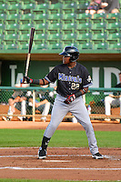Henry Castillo (22) of the Missoula Osprey at bat against the Ogden Raptors in Pioneer League action at Lindquist Field on August 5, 2014 in Ogden, Utah.  (Stephen Smith/Four Seam Images)