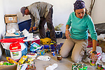 Andean Mountain Cat (Leopardus jacobita) biologists, Cintia Tellaeche and Juan Reppucci, organizing food for the field, Abra Granada, Andes, northwestern Argentina