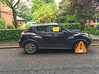 Untaxed vehicle clamped in Osborne Park, Malone, Belfast, N Ireland, 31st May 2019, 201905310522<br /><br />Copyright Image from Victor Patterson, 54 Dorchester Park, <br />Belfast, UK, BT9 6RJ<br /><br />t1: +44 28 9066 1296 (from Rep of Ireland 048 9066 1296)<br />m: +44 7802 353836<br />e: victorpattersonbelfast@gmail.com<br />w: www,victorpatterson.com<br /><br />Please see my Terms and Conditions of Use at https://www.victorpatterson.com/page2<br />It is IMPORTANT that you familiarise yourself with them.<br /><br />Images used on the Internet incur an additional cost and must be visibly watermarked i.e. © Victor Patterson within the body of the image and copyright metadata must not be deleted. Images used on the Internet have a size restriction of 4kbs and are chargeable at rates available at victorpatterson.com.<br /><br />This image is only available for the use of the download recipient i.e. television station, newspaper, magazine, book publisher, etc, and must not be passed on to any third party. It is also downloaded on condition that each and every usage is notified within 7 days to victorpattersonbelfast@gmail.com.<br /><br />The right of Victor Patterson to be identified as the author is asserted in accordance with The Copyright Designs And Patents Act (1988). All moral rights are asserted.