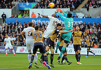 Andre Ayew of Swansea (10) is denied a header by goalkeeper Petr Cech of Arsenal during the Barclays Premier League match between Swansea City and Arsenal at the Liberty Stadium, Swansea on October 31st 2015