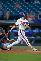 Grayson Byrd (4) of the Clemson Tigers follows through on his swing against the Duke Blue Devils in Game Three of the 2017 ACC Baseball Championship at Louisville Slugger Field on May 23, 2017 in Louisville, Kentucky. The Blue Devils defeated the Tigers 6-3. (Brian Westerholt/Four Seam Images)