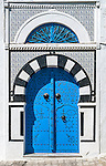 Bright blue coloured door in Sidi Bou Said, Tunisia. It is located about 20 km from the capital, Tunis. The town is named after a religious figure who lived there, Abou Said ibn Khalef ibn Yahia Ettamini el Beji. It is popular with tourists due to its extensive use of blue and white in its architecture. It also has a reputation as a town of artists.