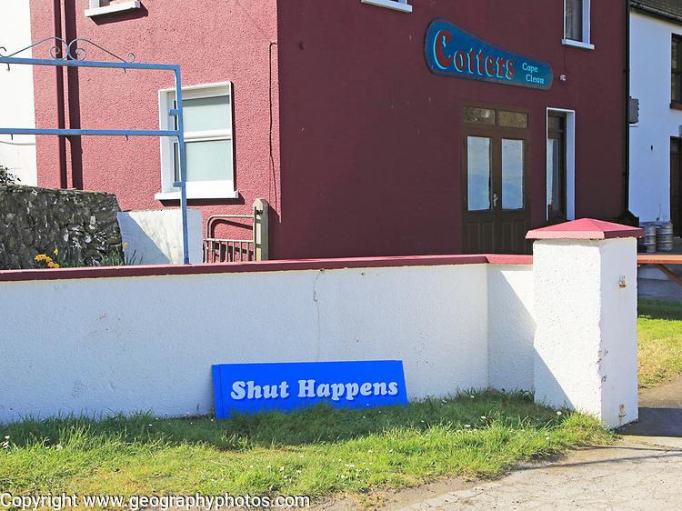 'Shut Happens' funny sign for closed Cotters bar pub, Cape Clear Island, County Cork, Ireland, Irish Republic