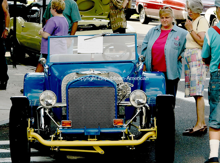 NAUGATUCK, CT - 05 AUGUST 2005 -080605JS01-- Cathy Davis of Naugatuck talks with friend Anne Butler of Naugatuck as Davis talks about her 1923 replica Model Street Rod during the second  annual Naugatuck Classic Car Show held Saturday in downtown Naugatuck  --Jim Shannon Photo--Cathy Davis, Anne Butler,  Naugatuck are CQ