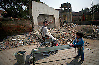 16-year-old Rani Pandey soaks in the sun and recovers from a painful bathing in the garbage-strewn courtyard outside the ward. Her family said she was burned in a kitchen accident, though evidence points to a possible dowry incident. Her husband from a recent marriage and his family never came to visit at the hospital