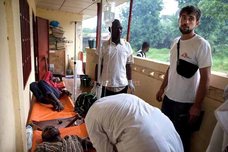 Ivan Quentin, right, a logistical coordinator with MSF, visits a government-run cholera treatment clinic in Coyah, Guinea, Aug. 17, 2012. Quentin and other members of the MSF team checked on the facility's supplies, hygiene practices, and the doctors' and nurses' ability to cope with an increased number of cholera patients. Médecins Sans Frontières is responding to a cholera outbreak in Guinea, which is affecting coastal areas and inland. Two emergency MSF cholera treatment centers in Conakry are receiving around 60 new cases per day, and a third treatment center opened over the weekend.