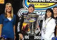 Nov. 20, 2009; Homestead, FL, USA; NASCAR Camping World Truck Series team owner Delana Harvick (left) with driver Ron Hornaday (center) and wife Lindy Hornaday after winning the truck series championship following the Ford 200 at Homestead Miami Speedway. Mandatory Credit: Mark J. Rebilas-