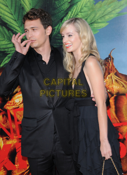 "JAMES FRANCO & ANHA O'REILLY.The Columbia Pictures' World Premiere of ""Pineapple Express"" held at The Mann's Village Theatre in Westwood, California on .July 31st, 2008 .half length black suit jacket dress couple anna hand gesture smoking funny.CAP/DVS.©Debbie VanStory/Capital Pictures."