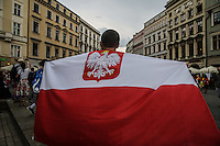 World Youth day Krakow 2016 giovane con bandiera polacca Polska flag