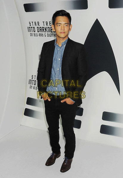 John Cho<br /> &quot;Star Trek Into Darkness&quot; DVD/Blu-Ray Release held at the California Science Center, Los Angeles, California, USA.<br /> September 10th, 2013<br /> full length jacket black blue shirt jeans denim hands in pockets <br /> CAP/ROT/TM<br /> &copy;Tony Michaels/Roth Stock/Capital Pictures