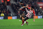 Raheem Sterling of Liverpool is challenged by Maya Yoshida of Southampton - Barclays Premier League - Southampton vs Liverpool - St Mary's Stadium - Southampton - England - 22nd February 2015 - Pic Robin Parker/Sportimage