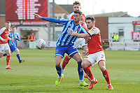 Blackpool's Gary Madine vies for possession with Fleetwood Town's Lewie Coyle<br /> <br /> Photographer Kevin Barnes/CameraSport<br /> <br /> The EFL Sky Bet League One - Fleetwood Town v Blackpool - Saturday 7th March 2020 - Highbury Stadium - Fleetwood<br /> <br /> World Copyright © 2020 CameraSport. All rights reserved. 43 Linden Ave. Countesthorpe. Leicester. England. LE8 5PG - Tel: +44 (0) 116 277 4147 - admin@camerasport.com - www.camerasport.com