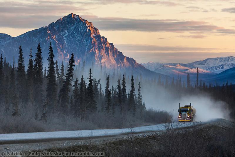 Truck on the James Dalton Highway, Mount Dillon in the distance, Brooks mountain range, arctic, Alaska.
