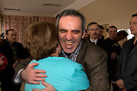 Yoshkar-Olinskii, Russia, 24/04/2005..Garry Kasparov embraces a woman at a local residents' meeting in the Kazan area in central Russia after she performed an impromptu traditional dance for him. Kasparov, World Chess Champion for the last twenty years, recently retired from the professional game to devote his time to Russian politics, and is currently touring the country and founding a new political movement in opposition to President Valdimir Putin.