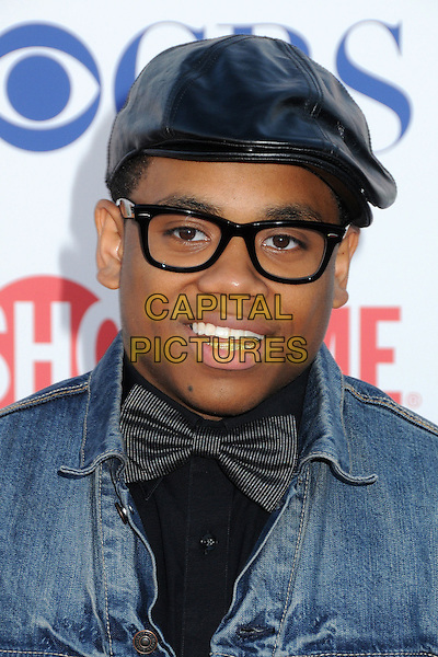 Tristan Wilds.CBS, CW and Showtime Summer 2011 TCA Party held at The Pagoda, Beverly Hills, California, USA..August 3rd, 2011.headshot portrait bow tie grey gray jean denim blue black hat glasses  .CAP/ADM/BP.©Byron Purvis/AdMedia/Capital Pictures.