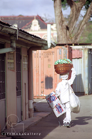 Dolly Dewdrop the sweet vendor, Port of Spain,  all in white carries her baskets to 3 Government Ministries every day.