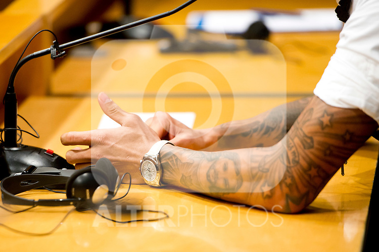 A detail of the watch and a tattoo in the left arm of FC Barcelona's Daniel Alves during a press conference at Camp Nou Stadium in Barcelona. November 5, 2013. (ALTERPHOTOS/Alex Caparros)
