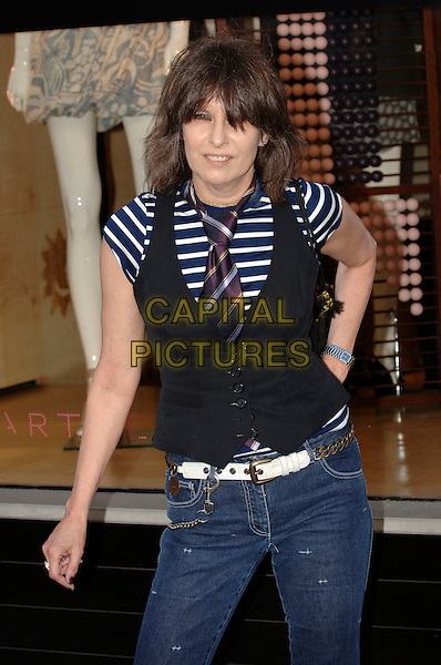 CHRISSIE HYNDE.PETA's Humanitarian Awards at Stella McCartney's Mayfair boutique.(People for Ethical Treatment of Animals) .28th June 2006 London England .Ref: PL.shop half length vest striped stripes tie .www.capitalpictures.com.sales@capitalpictures.com.©Phil Loftus/Capital Pictures