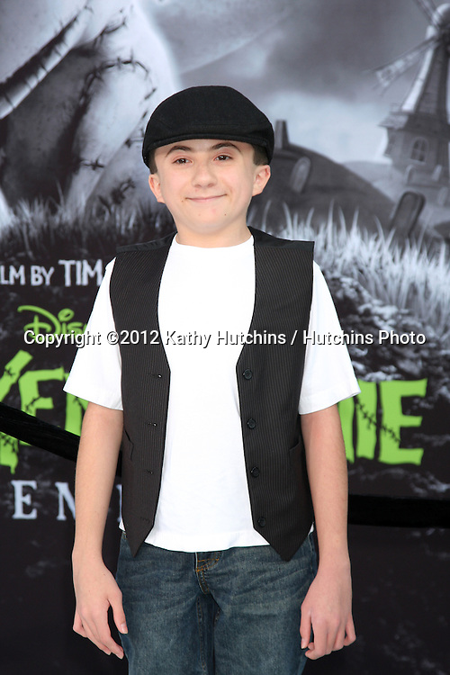 "LOS ANGELES - SEP 24:  Atticus Shaffer arrives at the ""Frankenweenie"" Premiere at El Capitan Theater on September 24, 2012 in Los Angeles, CA"