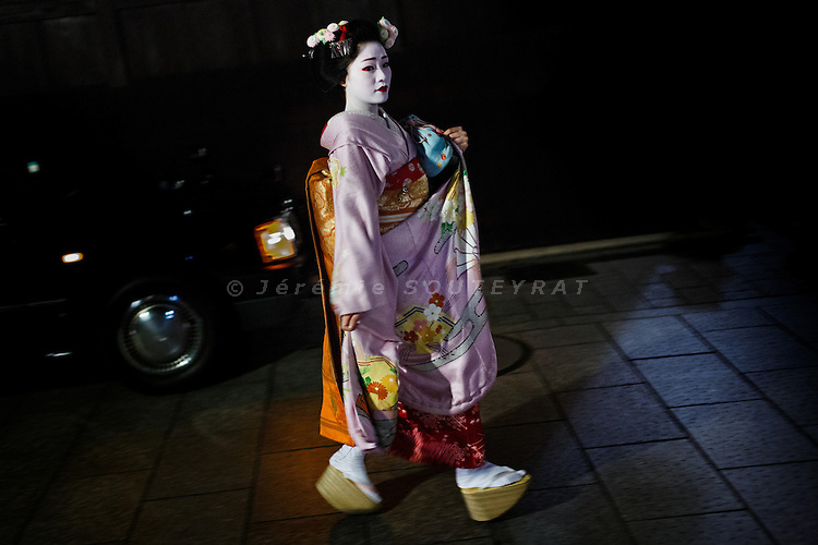 Kyoto, October 26 2012 - Maiko (apprentice geisha) on her way back from work at night.