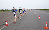 27 MAR 2011 - LOUGHBOROUGH, GBR - Ryan Ordidge (left) leads a group at the end of the first lap of the first run during the British Elite and Junior Mens Duathlon Championships .(PHOTO (C) NIGEL FARROW)