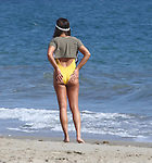 September 1st 2016  Exclusive <br /> <br /> <br /> Lea Michele jumping in the air wearing a bikini swimsuit for a photo shoot on the beach in Malibu California.  Lea was laughing having fun while wearing 3 different color outfits. Tight white , yellow &amp; Red one piece spandex swimsuit . The swimsuits were all very tight so you could see her nipple &amp; cleavage along with the thong butt look. <br /> <br /> www.AbilityFilms.com<br /> 805 427 3519 <br /> AbilityFilms@yahoo.com