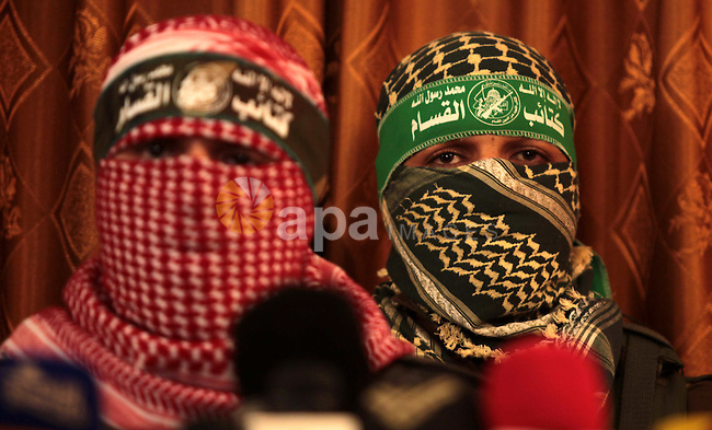 Spokesman of al-Qassam Brigade, the military wing of Hamas movement, Abu Obeida, speaks during a press conference in Gaza city on July 03, 2014. Last night Israel launched some dozen air strikes on northern Gaza and Gaza City, wounding nine Palestinians, as angry Palestinian youths clashed the previous day with Israeli police following the kidnap and murder of a Palestinian teen in an apparent revenge attack. Photo by Ashraf Amra