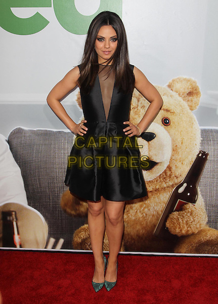 Mila Kunis.The L.A. Premiere of 'Ted' held at The Grauman's Chinese Theatre in Hollywood, California, USA..June 21st, 2012.full length black sleeveless dress sheer plunging neckline hand on hip green shoes .CAP/ADM/KB.©Kevan Brooks/AdMedia/Capital Pictures.