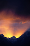 A dramatic sunset lights the clouds above the northern Teton Range, Grand Teton National Park, Jackson Hole, Wyoming.