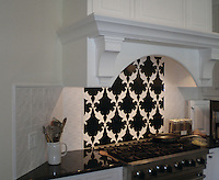 This custom kitchen features a handmade Tamara mosaic backsplash shown in Nero Marquina and Thassos from the Silk Road Collection by Sara Baldwin for New Ravenna. <br />