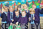 PHONE COLLECTION: Pupils of St Oliver's national school in Ballylongford collecting old mobile phones for charity, front l-r: Emer Walsh, Grainne Moriarty, Liam Mulvihill, Oran O'Neill, Bridget Flahive. Back l-r: Amy O'Brien, Jordyn McDonald, Denis Collins.