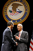 Washington, DC - March 27, 2009 -- United States President Barack Obama (L) shakes hands with U.S. Attorney General Eric Holder during his ceremonial installation at George Washington University March 27, 2009 in Washington, DC. Holder has been serving as the 82nd attorney general since he was confirmed by the Senate in February of this year. .Credit: Chip Somodevilla - Pool via CNP