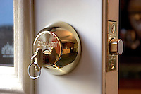 DEADBOLT LOCK<br /> Key In Lock<br /> Hardened steel bolt partially extended.