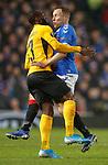 12.12.2019 Rangers v Young Boys Bern: Scott Arfield dancing with Nicolas Moumi Ngmaleu