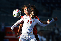 Oct 26, 2014; Philadelphia, PA, USA; Trinidad & Tobago midfielder Karyn Forbes (14) and Mexico midfielder Lydia Nayeli Rangel  (7) battle for the ball during the third place match of the CONCACAF Women's Championship at PPL Park. Mexico won 4-2.  Mandatory Credit: Derik Hamilton-USA TODAY Sports