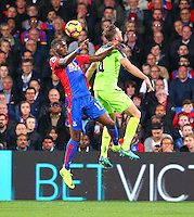 Christian Benteke of Crystal Palace beats Jordan Henderson of Liverpool  to a header during the EPL - Premier League match between Crystal Palace and Liverpool at Selhurst Park, London, England on 29 October 2016. Photo by Steve McCarthy.