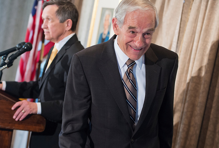 UNITED STATES - APRIL 17: Former Reps. Ron Paul, R-Texas, right, and Dennis Kucinich, D-Ohio, attend an event at the Capitol Hill Club to launch the Ron Paul Institute for Peace and Prosperity. (Photo By Tom Williams/CQ Roll Call)