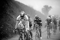 Sir Bradley Wiggins (GBR/SKY) riding through the dust, Niki Terpstra (NLD/OPQS) in his wheel<br /> <br /> Paris-Roubaix 2014